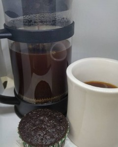 Nate's Espresso Blend in a french press with a chocolate cupcake