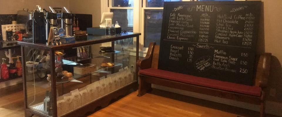 check-out counter at The Main Cup with coffee and tea on display