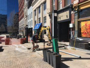 breaking ground to add new electric lines for Nate's Coffee Shop downtown Lexington Kentucky